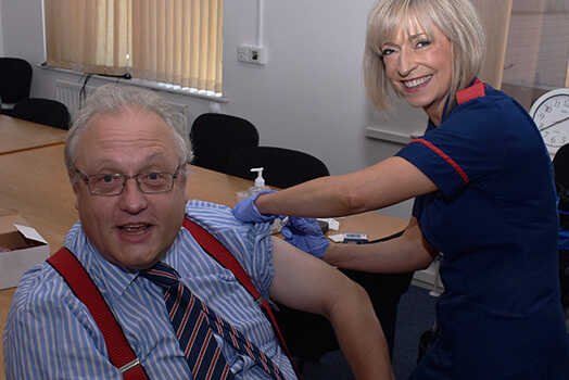Dr Charles Ashton receiving his flu jab