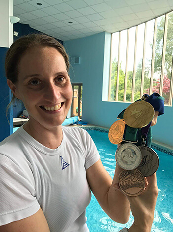 Year of wellbeing blogger Mel Barratt with her medals